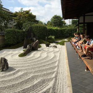 Students sitting on the veranda overlooking the abbot's garden at Zuiho-in